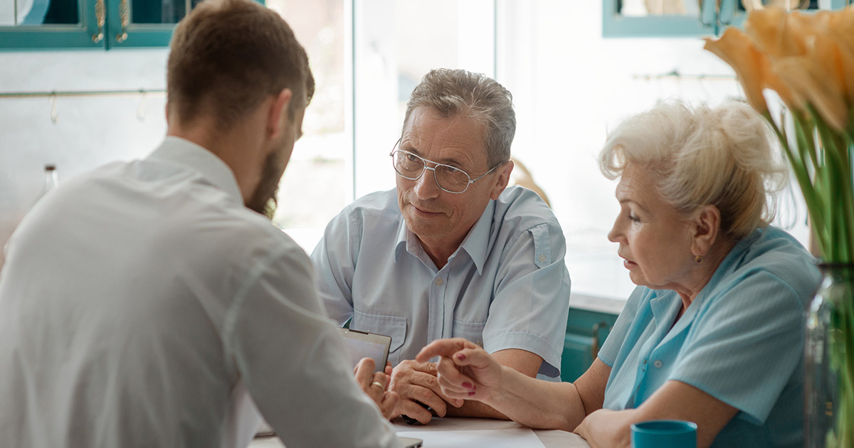 Senior couple speaking with a Care Specialist