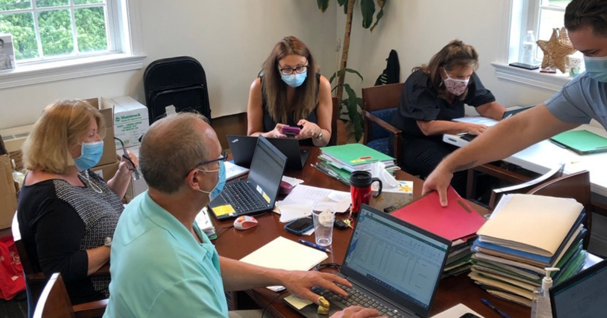 Wellness and ACHC teams working together in office